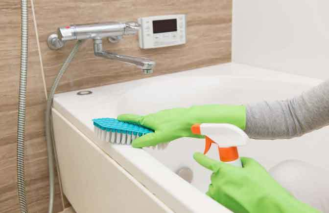 remove hard water stains from bathtub